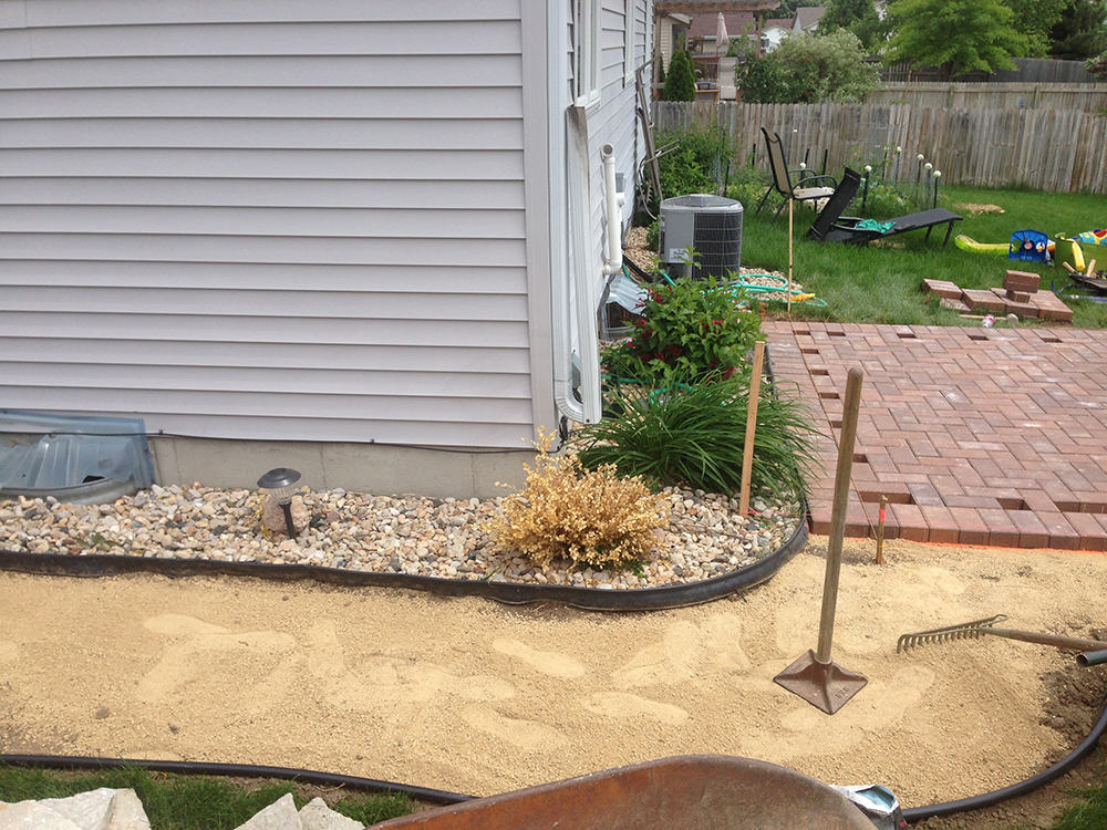 Brick patio and pathway during construction
